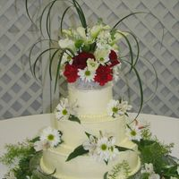 Simple Wedding Cake  This is a cake I made. It was very simple, All buttercream Bead border on top & bottom. The flowers were fresh. The florist didn't...
