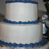 Practice Cake This is my third cake. It is the first tiered one that I have made. It is a white cake with a raspberry mousse filling. I am happy that...