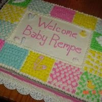 Quilt Cake This is my first baby shower cake. I started cake decorating last November. It was for a 3rd grade teacher who was given a surprise baby...