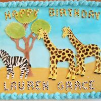 Safari Birthday Animals and tree are shapes cut out of flat fondant. I used yellow dust to color the giraffe and then dust mixed with almond extract to...
