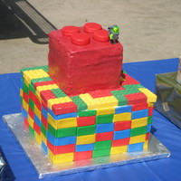 Lego Cake I used a Lego ice cube tray to make candy melt Legos, the sides of the bottom are fondant rectangles.