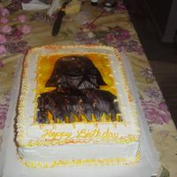 Darth Vader Marble cake frosted in buttercream. I striped the bag with yellow and orange to pick up the back round of the picture. The picture is...