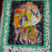 Scooby Doo Cake I used a picture our of a coloring book and transferred it on to edible paper. Then I painted the characters with colored piping gel.