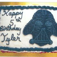 Darth Vader Birthday Cake This is chocolate fudge cake with chocolate filling and vanilla buttercream covers the outside. It was a special request from a 4 yr old...