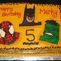 Superheros White and chocolate cake with buttercream transfers!
