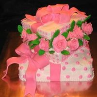 Package Full Of Roses   Fondant roses, fondant bows. Buttercream accents.
