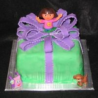 Dora Surprise Covered in mm fondant and mm fondant bow. Same thing here. Actually, I got the two pic mixed up!!! OH well. Both my daughters LOVED their...