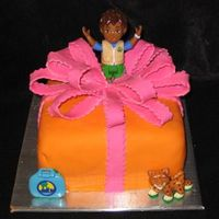 Dora Surprise  Covered with mm fondant and mm fondant bow. Tried to make a Dora out of a mini bear pan....didn't look good, so I put in a toy! My...