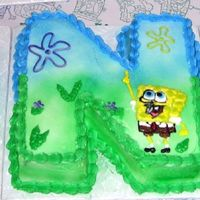 Sponge Bob First Birthday Cake Although Sponge Bon is not a favorite of mine, this cakes was so much fun! I made one round and two square ten inch cakes, then carved them...