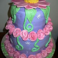 Tinker Bell Cake tinker bell cake minus the tink,she will be put on by customer{didnt want her to fall off} Vanilla pound with buttercream top is chocolate...