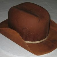Leather Cowboy Hat This is my very first cowboy hat! I had so much fun making this cake, I can't wait to do another. The brim is made from gumpaste and...
