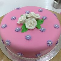 First Fondant Cake butter cake covered in fondant and fondant decor... gumpaste roses...thanks for looking!