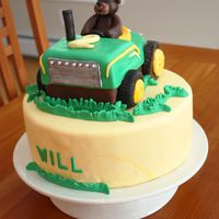 Tractor And Bear Cake Tractor cake is a Chocolate PB&J cake, chocolate cake filled with black raspberry jam, fresh raspberries and peanut butter dulce de...