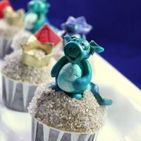 Dragon Cupcakes all edible, dragons have malt balls in their bellies as a nice little surprise :)