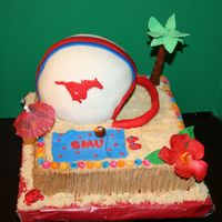 Smu Football Season Kickoff Luau butter creme with fondant and gumpaste decorations helmet covered in fondant Thanks to sugar fancy and cakesby allison for ideas and...