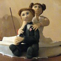 Shrout_Figures.jpg Bride wanted the groom's cake to have a subtle homage to Star Wars. So groom has a light saber and she has the hair...