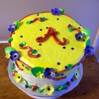 Angie's Garden Birthday Cake Buttercream cake with fondant accents single layer topsy turvy style.