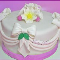 Bows And Flowers Wedding Cake