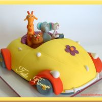 A Happy Party In A Vw Vanilla cake, covered with sugar paste. The animals are also fondant