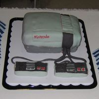 Nintendo Groom's Cake Strawberry Cake decorated with fondant.