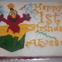 Elmo Cake Made for friends' daughter's first birthday. Also included (as seen in second photo) a small elmo in a car cake for grandpa that...