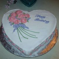 Hpim0142.jpg This was a cake for my mother's birthday. It cound have been ten times better if the roses stopped wilting. Not too bad for a sixteen...