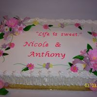 Shower Cake The cake was purchased, undecorated, from the Bride's favorite bakery. It is one layer vanilla, one choclate with Cannoli filling. A...