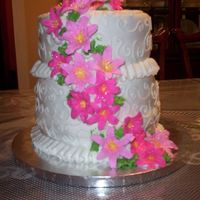 "Pink Lillies And Scrolls This was my first ""wedding"" type cake. It actually could be a cake for MANY ocasions, I made it as my final cake in the Wilton..."
