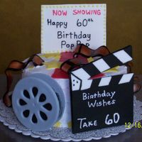 Movie Theme Cake A friend came up with this design and we did this cake for a Birthday of someone who was in the film business. The cake is vanilla iced...