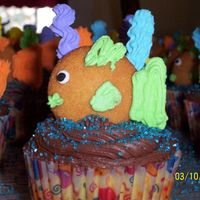 Fish Cupcakes Vanilla cupcakes with chocolate ganache icing. Fish made out of Nilla wafer cookies and royal icing.