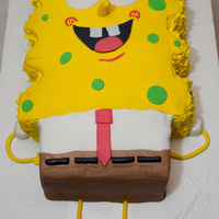 "Sponge Bob 10"" x 13"" white cake cut to size for Sponge Bob's shape. Covered in homemade vanilla icing and fondant accents. The birtday..."