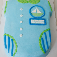 "Baby Shower Onesie Single layer white 11""x15"" carved onesie covered in vanilla buttercream. Fondant sail boat and plaque."