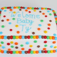 "Welcome Baby Ty 9""x13"" double layer strawberry cake with sliced strawberries in between labels. Covered in buttercream with buttercream polka..."
