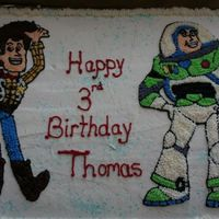 Buzz And Woody Buttercream icing. Traced images from colouring pages. Star tip #13 and number 2 and #1 tips used for outlines. It took some time but I...