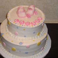 "Baby Shower Cake 11"" round on bottom 8"" round on top. All buttercream except shoes, ribbon roses and name"