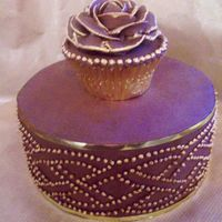 Celtic Baileys Ganache Top Tier Chocolate mud cake with Baileys ganache. First time covering a cake in ganache (usually just use mmf). Ganache rose cup cake with some gold...