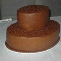 Grooms Cake This was my first grooms cake. Chocolate, chocolate buttercream. My first cornelli lace. In retrospect I should have kept the top layer a...