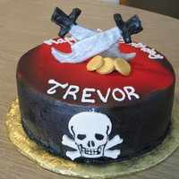 "Pirate Birthday 10"" pink lemonade cake with bavarian cream filling, buttercream icing and fondant decorations. Black was sprayed with a Prevail..."