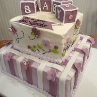 Plum Baby Shower This was done to match the nursery bedding - Disney Coco Plum Butterflies. All butter cream with fondant stripes/flowers/butterflies. 12...