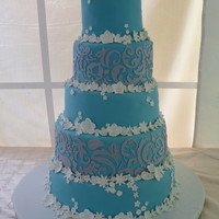 5 Tier Ocean Blue The silver area was done with the Cricut all the flowers are gumpaste. Once my business partner got the right mix of gumpaste, Satin Ice,...