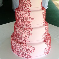 Red Piping Wedding Cake Pale pink fondant with red royal piping.