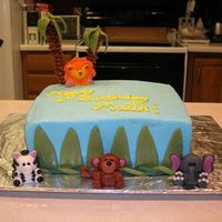 Jungle Birthday Cake I made this for my son's 1st birthday. It is BC with MMF decorations (animals included). The cake was 1/2 chocolate, 1/2 orange...