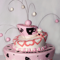 Hello Kitty Cake   Whimsical Cake covered with MMF, Decoration (cricut cake) and gumpaste and Hello Kitty made out of gumpaste.Thanks for checking ; )