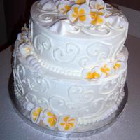 Plumeria Wedding Cake Lilikoi(passion fruit) chiffon cake with buttercream frosting and hand made fondant plumerias and seashells