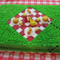 Picnic Buttercream icing. Decorations are made from fondant. Ants are plastic.