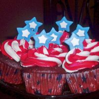 Stars And Stripes Red velvet cupcakes with cream cheese buttercream. Stars are fondant/gumpaste mixture. Wilton star cake cups completely disappear when you...