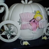 Cinderella's Carriage This is the William and Sanoma pumpkin bundt pan. The cake came out of Debbie Brown's Fairy Princess book. The cake is covered in...