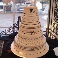 "Jennifer's Wedding Cake  This cake is from a Las Vegas cake store. The bride showed me the picture and changed the background color to ""Diamond White"" ie..."