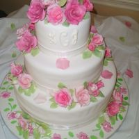 Leigh's Wedding Cake  This is a 3 teired fondant covered wedding cake as a gift for my cousin. The roses are assorted soft pink to light mauve colores. They were...