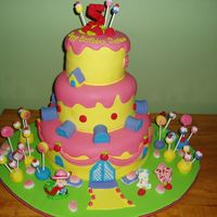Strawberry Shortcake  This was for a 5 year olds birthday. This is out of the 2006 Wilton book. It is a 3 tiered fondant covered cake with the Wilton Strawberry...